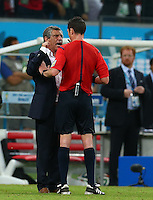 Greece coach Fernando Santos argues with referee Benjamin Williams at full time