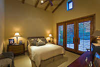 Guesthouse bedroom with shuttered french doors