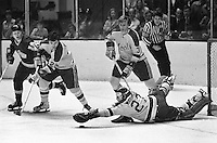 Seals goalie Giles Meloche makes save, Ernie Hicke and Paul Shmyr...(photo/Ron Riesterer)
