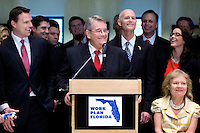 TALLAHASSEE, FLA. 5/3/13-SESSIONEND050313CH-Senate President Don Gaetz, R-Niceville, center, talks about the accomplishments of the 2013 session during a news conference with House Speaker Will Weatherford, R-Wesley Chapel, left, and Gov. Rick Scott, right, May 3, 2013 at the Capitol in Tallahassee. Victoria Quertermous, wife of President Gaetz, is at right. ..COLIN HACKLEY PHOTO