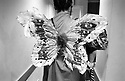 Peter and his butterfly wings walking in the corridor backstage ready to go on stage for the Donkisjot performance. Brussels, Belgium, 2006