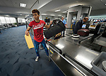 Edwin Chacon, an asylum seeker from Honduras, passes through the TSA checkpoint on his way to board a flight at the Valley International Airport in Harlingen, Texas. Chacon, 18, got a ride to the airport from the Posada Providencia in San Benito, where he stayed for several days after being released by immigration authorities pending a judicial hearing on his asylum request. He was on his way to stay with a relative elsewhere in the United States.<br /> <br /> Sponsored by the Catholic Sisters of Divine Providence, the Posada Providencia provides a safe place for people in crisis from all over the world who are seeking legal refuge in the United States.