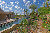 Stone paved path leads around pool