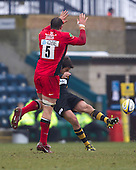 Nick Robinson of London Wasps RFC clears ahead of an attempted charge down from Hayden Smith of Saracens RFC - London Wasps RFC vs Saracens RFC - Aviva Premiership Rugby at Adams Park, Wycombe Wanderers FC - 12/02/12 - MANDATORY CREDIT: Ray Lawrence/TGSPHOTO - Self billing applies where appropriate - 0845 094 6026 - contact@tgsphoto.co.uk - NO UNPAID USE.