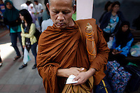A Buddhist monk waits among Muslim passengers before boarding a heavily secured train in the troubled Yala province in southern Thailand February 28, 2011. Separatists are blamed for most of the attacks on Thailand's predominantly Muslim deep south, which often target Buddhists and Muslims associated with the Thai state, such as police, soldiers, government officials and teachers. No credible group has claimed responsibility for near daily drive-by shootings and bombings, which continue unabated, despite a massive counterinsurgency effort. Yala and Pattani are two of three Muslim-dominated provinces bordering Malaysia where more than 4,300 people, both Muslims and Buddhists, have been killed in a low-level insurgency since 2004.   REUTERS/Damir Sagolj (THAILAND)