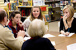 MORRIS, CT- 05 JANUARY 2008 --010509JS01-Members of the newly formed Teen Advisory Council, from left, Paige Fischer, Robin Morris and Kirsten Wyatt, talk with advisors Bob Asman and Lorraine Keer Faison during a meeting Monday at the Morris Public Library. During the meeting the group talked about plans for the upcoming council-sponsored &quot;Game Afternoon&quot; on Jan. 19 as well as discussion of ideas for the council's participatioin in Morris' 150th celebration. <br /> Jim Shannon / Republican-American