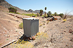 Chappo Spring at the base of the Resting Spring Range..Corrugated metal two-holer outhouse