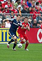 22 May 2010: New England Revolution midfielder Marco Perovic #29 and Toronto FC defender Dan Gargan #8 in action during a game between the New England Revolution and Toronto FC at BMO Field in Toronto..Toronto FC won 1-0.....