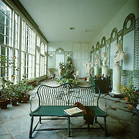 The interior of the 19th century orangery is lined with classical busts and statues