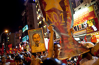 Vietnamese people take to the streets in celebration after Vietnam defeated Singapore 4-1 in the Southeast Asian Games semi-final soccer match in downtown Ho Chi Minh City, Vietnam.