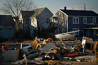 Debris are seen on streets for being removed by Heavy machinery after Hurricane Sandy hit town one month ago in Seaside Heights, New Jersey, November 28, 2012.