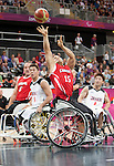 LONDON, ENGLAND 30/08/12: David Eng competes in the Men's Wheelchair Basketball preliminary round CAN vs. JPN at the London 2012 Paralympic Games at the Basketball Arena (Photo by: Courtney Pollock/Canadian Paralympic Committee)