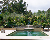 The focal point of the swimming pool is a statue at the far end by Barbara Hepworth