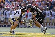 Annapolis, MD - April 15, 2017: Navy Midshipmen Brady Dove (55) wins the faceoff during game between Army vs Navy at  Navy-Marine Corps Memorial Stadium in Annapolis, MD.   (Photo by Elliott Brown/Media Images International)