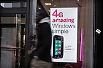 A man walks next to a banner of the new Nokia Windows Smartphone Lumia 710 in a T-Mobile store in New York, United States. 11/01/12.  Photo by Kena Betancur / VIEWpress.
