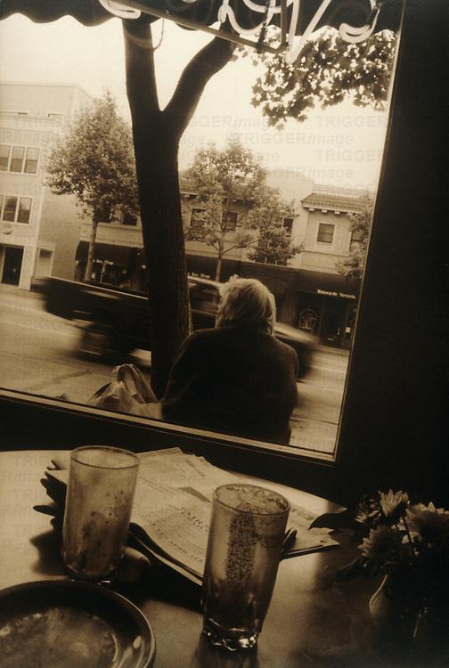 woman waiting outside café
