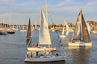 Yachts and sailboats sail on Spa Creek, returning from Wednesday Night Racing activities in Annapolis, Maryland.