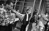 A man reads from the bible through a megaphone as New Yorkers, and visitors from all over the world, stop on lower Broadway to look at the smouldering buildings of the World Trade Centre complex, and to remember and pay tribute to the victims of the September 11th 2001 terrorist attack on the World Trade Centre buildings in Lower Manhattan by AL-Qaeda terrorists. New York, America.
