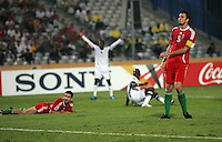Hungary's Andras Debreceni (5) watches as Ghana's earns a goal during the FIFA Under 20 World Cup Semi-final match at the Cairo International Stadium in Cairo, Egypt, on October 13, 2009. Costa Rica won the match 1-2 in overtime play. Ghana won the match 3-2.