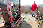 WATERBURY, CT. 08 January 2008-010408SV01--Cliff Lennox, engineer in charge of rebuilding the cross at Holy Land looks at the base of the cross in Waterbury Friday. The Holy Land Cross will be dismantled and rebuilt with new lighting.<br /> Steven Valenti Republican-American