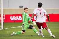 CD Chivas USA goalkeeper Dan Kennedy (1) forces Roy Miller (7) of the New York Red Bulls to shoot wide during the first half  of a Major League Soccer (MLS) match at Red Bull Arena in Harrison, NJ, on May 23, 2012.