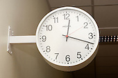 A traditional wall-mounted hospital clock. Royalty Free