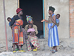 These woman and their children were displaced by October 2008 fighting between forces of rebel Tutsi General Laurent Nkunda and the Congolese government and fled to the provincial capital of Goma, where they have taken refuge with several other families in a Methodist church and adjacent school. Action by Churches Together International has provided food, non-food items, and shelter support for these families. A quarter of a million people have been newly displaced by fighting in the eastern Congo, where some 5.4 million have died since 1998 from war-related violence, hunger and disease. .