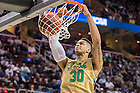 Mar. 26, 2015; Zach Auguste dunks against Wichita State in the regional semifinal of the 2015 NCAA Tournament. (Photo by Matt Cashore/University of Notre Dame)