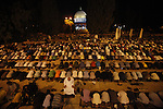"Palestinian Muslim men take part in an evening prayer ""Taraweeh"" in front of the Dome of the Rock at the Al-Aqsa mosque compound in the old city of Jerusalem during the fasting month of Ramadan on July 31, 2012. Photo by Saeed Qaq"