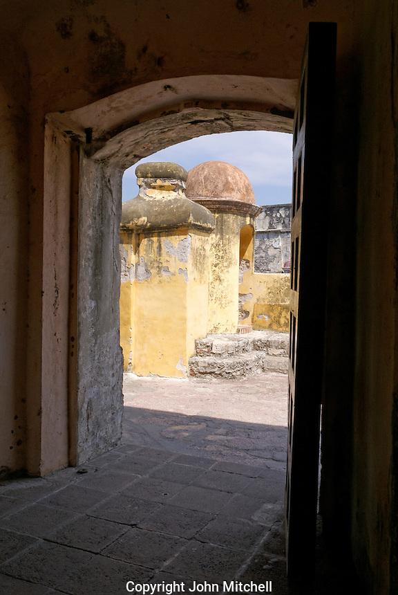 Open wooden door at the San Juan de Ulua fortress in the city of Veracruz, Mexico