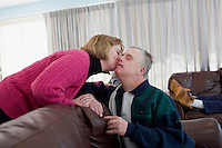 Julie Leahy kisses her brother Eddie Galvin, 54, after lunch in the residences in Malone Park at the Fernald Developmental Center in Waltham, Massachusetts, USA.