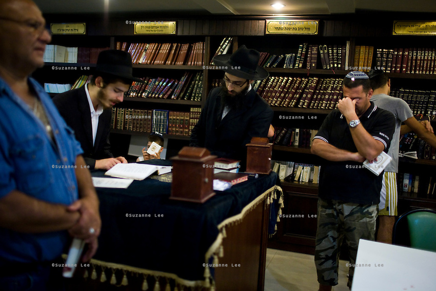 Jewish travellers and residents of the popular Thai tourist island of Koh Samui pray in the Chabad House of Koh Samui with Rabbi Goldshmid (center) during Chanuka celebrations on 17th December 2009. Koh Samui is the smaller of 2 islands next to each other, world renowned for the monthly full moon rave parties on the beach..Photo by Suzanne Lee / For Chabad Lubavitch