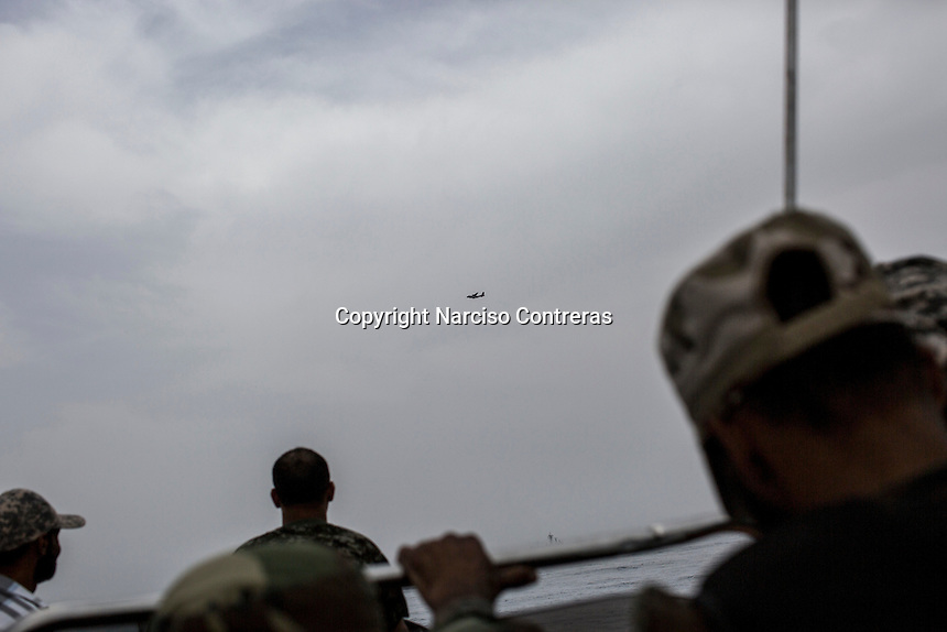 Surveillance operations carried out by NATO aircraft and Libyan coastguards in the Mediterranean Sea, looking for the boats of migrants.