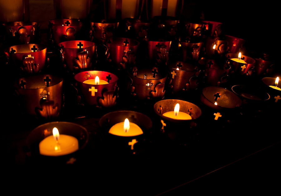 Candles in church during a christian celebration. Use of selective focus.