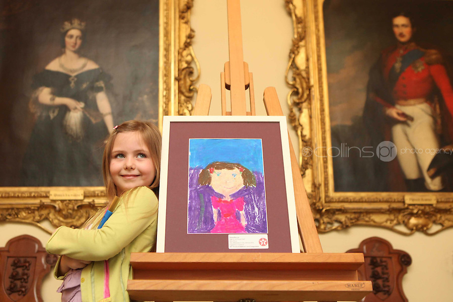 """06/04/2009.Jenna Reeves (5) from Limerick with her painting entitled """"New Dress"""" which came 3rd in category F (4-6 year olds) during the Texaco Childrens Art Competition at Dublin Castle, Dublin..Photo: Gareth Chaney Collins"""