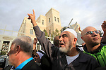 Leader of the radical northern wing of the Islamic Movement in Israel, Sheikh Raed Salah, gestures outside a Jerusalem court after he was convicted on October 27, 2015. An Israeli court upheld a conviction of the firebrand Islamic cleric and jailed him for 11 months for inciting violence over Jerusalem's Al-Aqsa mosque in 2007. Photo by Mahfouz Abu Turk