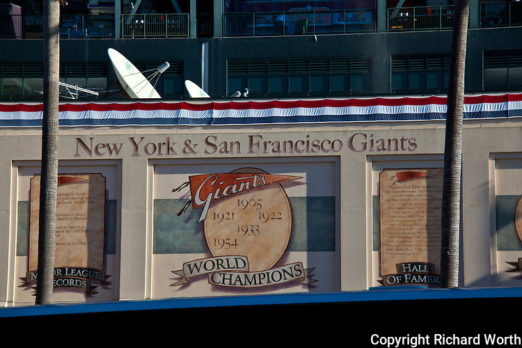 The facade outside AT&T Park the day the Giants won the 2010 World Series.  On top, microwave dishes that won't be used till next season.  The winning game was played 'away',
