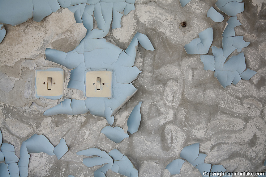 Light switches in a bedroom of Hotel Polissia. The peeling paint is the result of 21 years decay.<br /> Pripyat (Pripiat), 1km from the reactor, was designed as an exemplar of Soviet planning for the 50,000 people who worked at the Chernobyl Nuclear Power Plant in 1986 the result was the worst nuclear accident in history. Now a ghost town in Ukraine, Pripyat is in a radioactive exclusion zone unfit for human habitation for hundreds of years. This image was taken in 2007 over 5 hours, apparently the safe period of exposure.<br /> <br /> This image was exhibited at the Architectural Association, London in the exhibition &quot;Pripyat: 21 Years After Chernobyl, photographs by Quintin Lake&quot; 2008<br /> <br /> The image is also published in the book &quot;Drawing Parallels, Architecture Observed&quot; by Quintin Lake