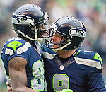Seattle Seahawks punter Jon Ryan (9) celebrates with coverage man Richardo Lockette (83) After Lockette put a smashing tackle on  St. Louis Rams return specialists Justin Veltung during the third quarter at CenturyLink Field in Seattle, Washington on December 29, 2013.  Seahawks clinched the NFC West title and home-field advantage throughout the playoffs with a 27-9 victory over the St. Louis Rams.  ©2013. Jim Bryant Photo. ALL RIGHTS RESERVED.