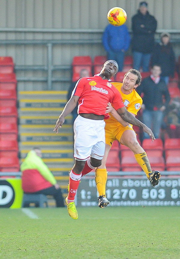 Preston North End's Kevin Davies battles in the air with Crewe Alexandra's Anthony Stewart<br /> <br /> Photographer Craig Thomas/CameraSport<br /> <br /> Football - The Football League Sky Bet League One - Crewe Alexandra v Preston North End - Sunday 28th December 2014 - Alexandra Stadium - Crewe<br /> <br /> &copy; CameraSport - 43 Linden Ave. Countesthorpe. Leicester. England. LE8 5PG - Tel: +44 (0) 116 277 4147 - admin@camerasport.com - www.camerasport.com