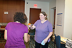 "March 11, 2010. Raleigh, North Carolina.. The first N.C. Poverty Simulation Experience training session was held at the 40th Annual State Head Start Conference at the Raleigh Convention Center.  . Nearly 60 individuals, including staff and parents from Head Start programs and Community Action Agencies, engaged in role playing exercises that hoped to simulate the experience of being poor and what the poor go through on a daily basis.. The ""thief"" holds the ""police officer"" at gunpoint after robbing a ""family""."