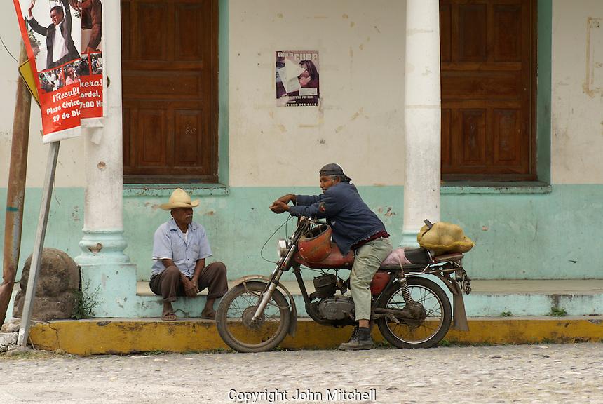 Two Mexican men relaxing in the village of La Antigua, Veracruz, Mexico