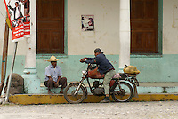Two Mexican men relaxing in the village of La Antigua, Veracruz, Mexico