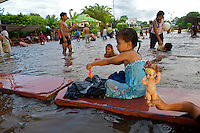Puerto Narino - The Amazon River floods the town soccer field turning it into a makeshift swimming pool - Amazonas - Colombia