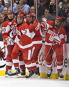 Corey Trivino (BU - 10), Garrett Noonan (BU - 13), Adam Clendening (BU - 4), Wade Megan (BU - 18) - The Boston College Eagles defeated the Boston University Terriers 3-2 (OT) in their Beanpot opener on Monday, February 7, 2011, at TD Garden in Boston, Massachusetts.