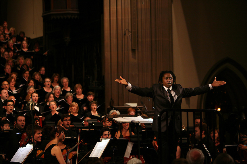Guest Artist Melanie DeMore conducts the audience through Amazing Grace during Remember to Love: Let Us Love One Another With A Sincere Heart, an observation of the 10th Anniversary of September 11 at Trinity Church in Manhattan, NY on September 09, 2011. The six choirs performing include NYC Master Chorale, Trinity Choir, Young People's Chorus of New York City, The Washington Chorus, The Bach Choir of Bethlehem and The Copley Singers.