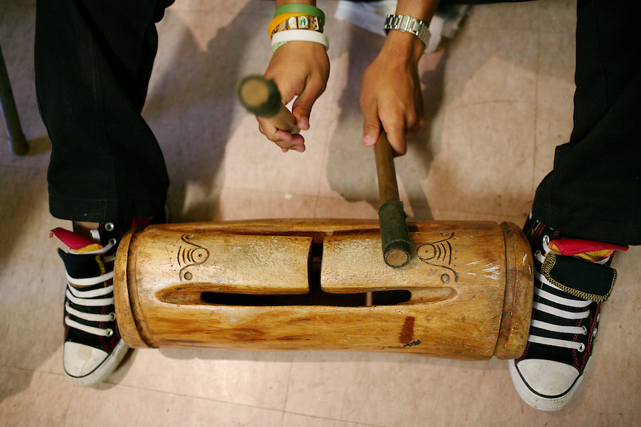 Fernando Soto, 15, plays a replica of a Taino wooden drum during a folklorico dance at the Instituto de Cultural Puertorriqueña, a cultural center in Jayuya, Puerto Rico, on Monday, November 17, 2008. Residents will celebrate the 39th annual Festival Indigena de Jayuya, which honors their Taino Indian heritage, this weekend. This year's festival represents the musical instruments of the Tainos.