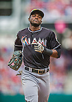 22 September 2013: Miami Marlins infielder Adeiny Hechavarria trots back to the dugout during a game against the Washington Nationals at Nationals Park in Washington, DC. The Marlins defeated the Nationals 4-2 in the first game of their day/night double-header. Mandatory Credit: Ed Wolfstein Photo *** RAW (NEF) Image File Available ***