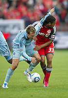 Sporting KC defender/midfielder Michael Harrington #2 and Toronto FC forward Javier Martina #33 in action during an MLS game between Sporting Kansas City and the Toronto FC at BMO Field in Toronto on June 4, 2011..The game ended in a 0-0 draw...