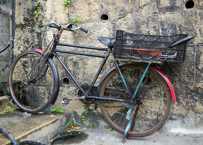 Hong Kong urban scene - bicycle against weathered wall